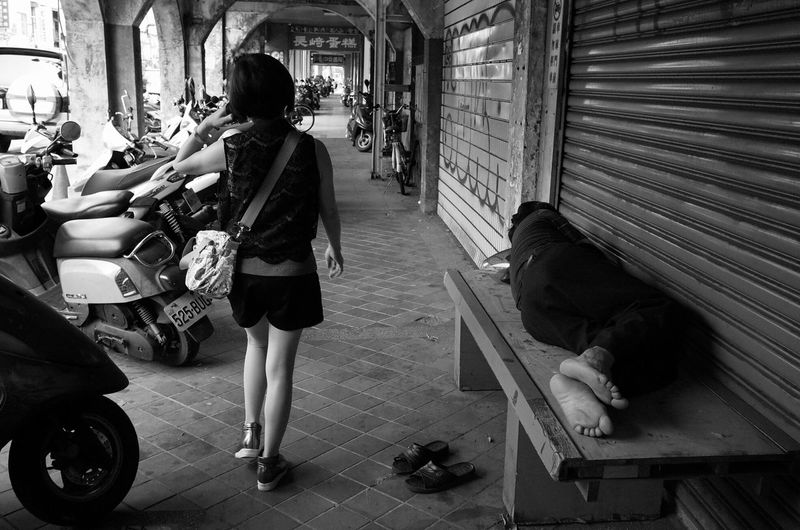 It's just a moment in time, but it's common in a capitalist society. in Taichung, Taiwan. Streetphotography The Storyteller - 2014 Eyeem Awards EyeEm Best Shots Taiwan