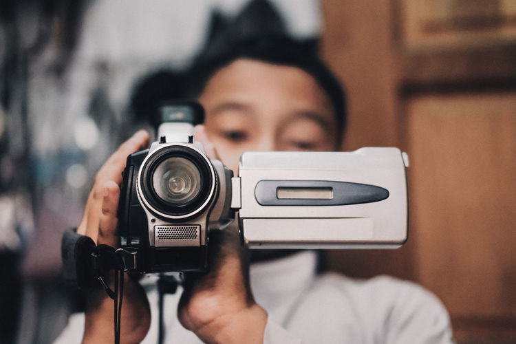 Boy recording video with camera