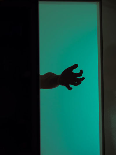 Close-up of hand on glass window