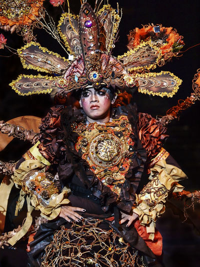 Spectacular Costumes worn by Participants in Jember Fashion Carnaval. One of the top local festivities in Indonesia and 4th biggest carnaval in the world. Black Background Carnival Celebration EyeEm Best Shots Carnaval Colorful Costume Culture Facial Expression Festival Festive Front View Glamour Jember Fashion Carnival Light And Shadow Parade Performing Arts Event Traditional Costume