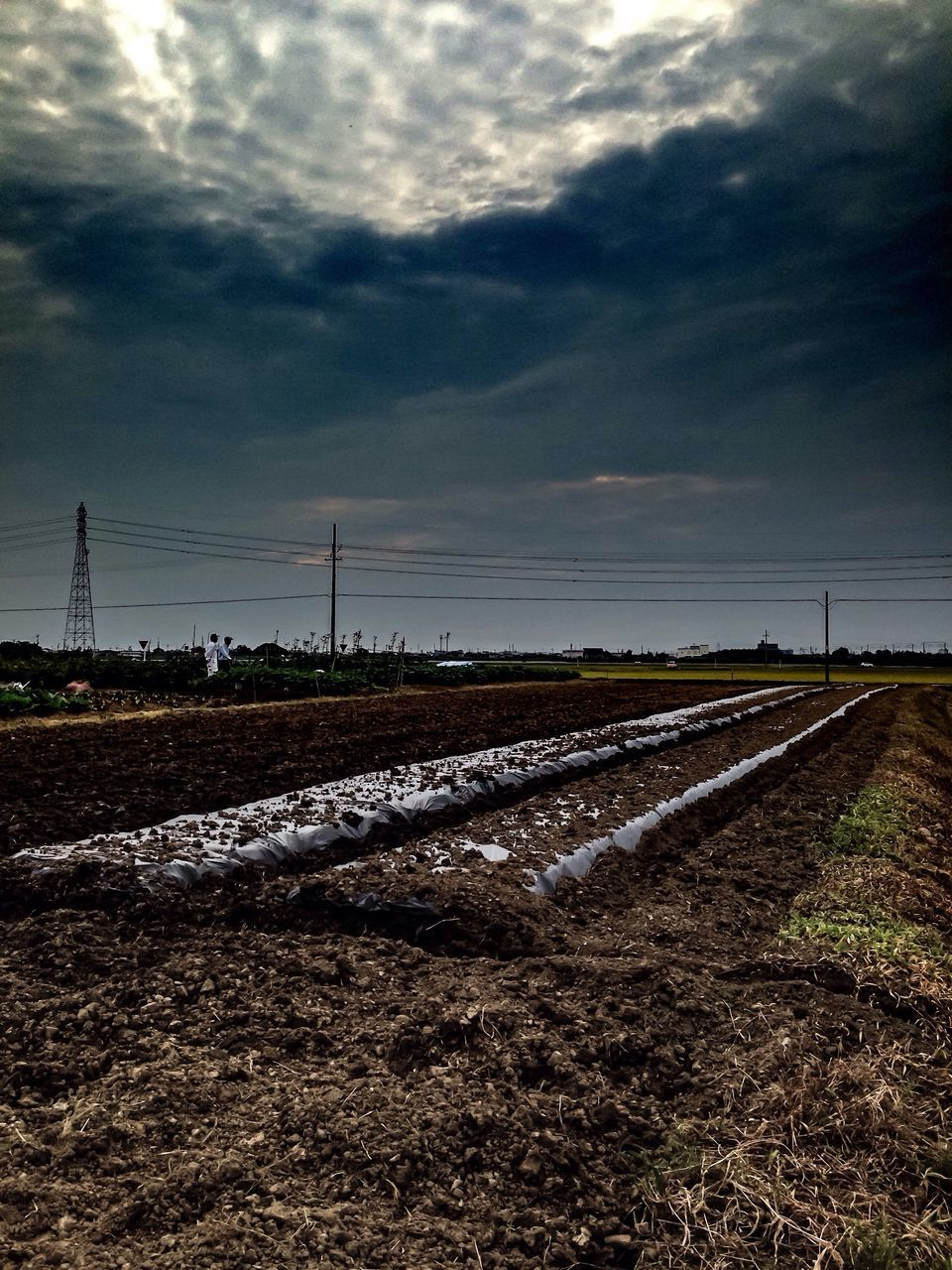 sky, cloud - sky, landscape, agriculture, field, nature, rural scene, no people, day, tranquility, tranquil scene, scenics, outdoors, plough, beauty in nature, plowed field, electricity pylon