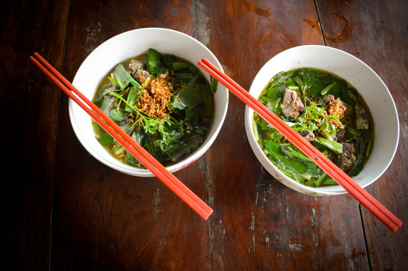 Red Chopsticks Chopsticks Food And Drink Bowl Noodle Soup Beef Noodle Soup Ready-to-eat Healthy Eating Cambodian Cuisine Freshness Food Phnom Pehn, Cambodia Close-up Two Bowl Of Noodles
