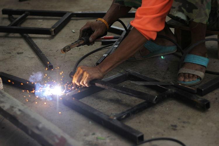 Low section of welder welding metal