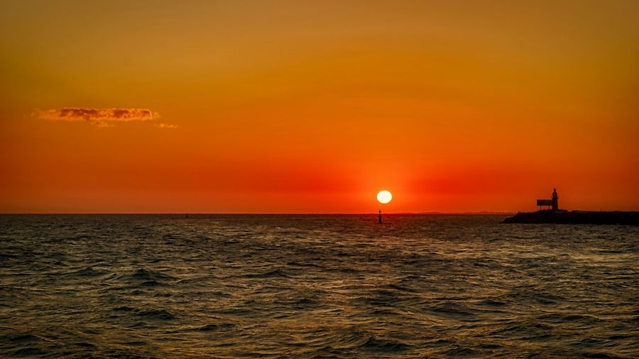 Sunset Sky Sea Water Sunset Horizon Over Water Beauty In Nature Scenics - Nature Orange Color Tranquil Scene Tranquility Sun Idyllic Horizon Waterfront Cloud - Sky Silhouette Outdoors No People