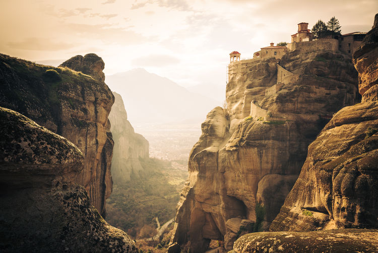 Sacred by Anna Wacker Photo taken in Meteora, Greece Meteora Monasteries Beauty In Nature Environment Eroded Formation Geology Meteora Greece Meteora; Greece; Monastery; Holy; Orthodox; Landscape; Church; Rock; Mountain; Cliff; Architecture; Religion; Christian; View; Beautiful; Abbey; Rousanou; Valley; Faith; Miraculous; Pray; Pilgrim; Kalambaka; Trinity; Summer; Unesco; Travel; Tourism Mountain Mountain Peak Mountain Range Nature No People Non-urban Scene Outdoors Physical Geography Rock Rock - Object Rock Formation Rocky Mountains Scenics - Nature Sky Tranquil Scene Tranquility Travel Destinations