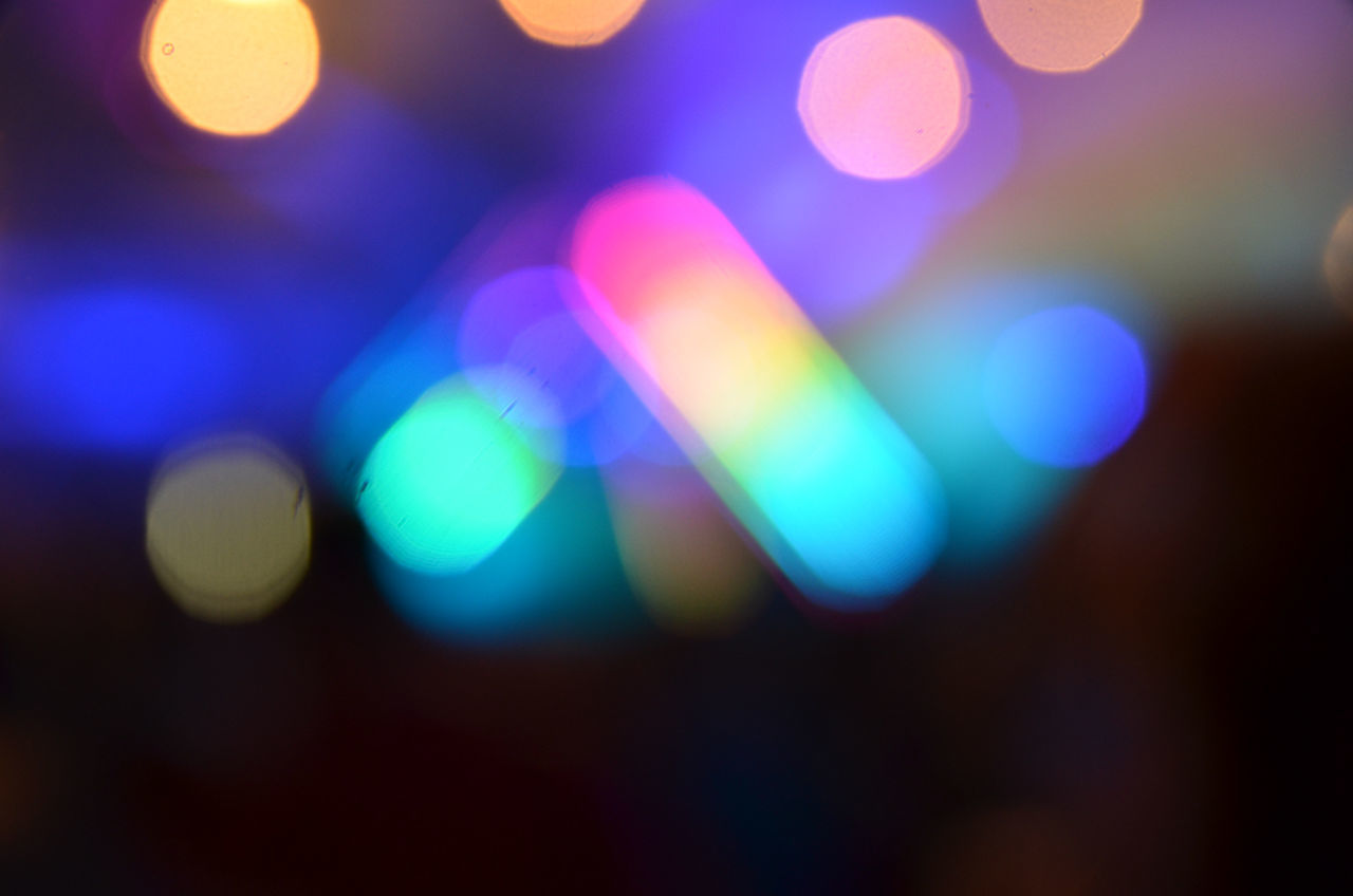 illuminated, defocused, multi colored, lighting equipment, night, glowing, light effect, abstract, no people, backgrounds, close-up, focus on foreground, outdoors, disco lights, projection equipment