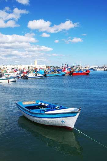 Setúbal, Portugal Anchored Blue Boats Cloud - Sky Fishing Boat Fishing Industry Harbor Mode Of Transportation Nautical Vessel Pier Reflection Transportation Water Waterfront