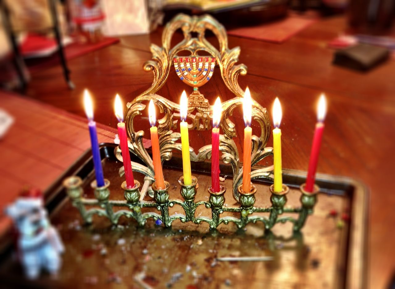 High angle view of burning colorful candles at home during hanukkah
