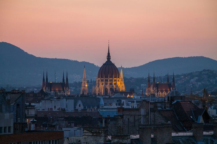 The Parliament rises above. Architecture Dome International Landmark Cityscapes Twilight Budapest Hungary Rooftop Travel Destinations Parliament Parliament Building