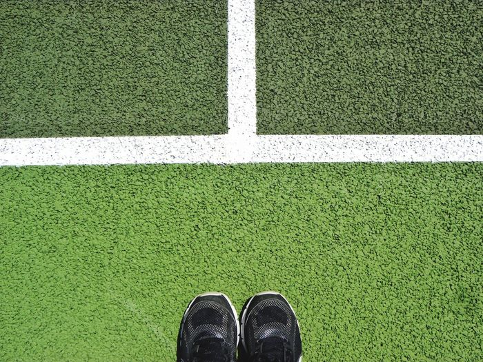 Low section of person standing on playing field
