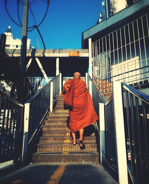 City Life Monk  Priest Buddha Buddhism Receive Food Morning Sunrise Outdoors One Person Sky Day Adults Only People Adult Yellow Robe Bare Feet Plainly EyeEm Best Shots EyeEm EyeEm Masterclass