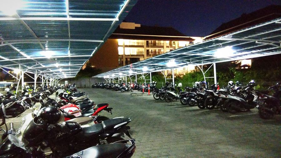 parking lot Illuminated Motorcycle Land Vehicle City Bicycle Architecture Built Structure Parking Parking Lot Scooter Motorbike