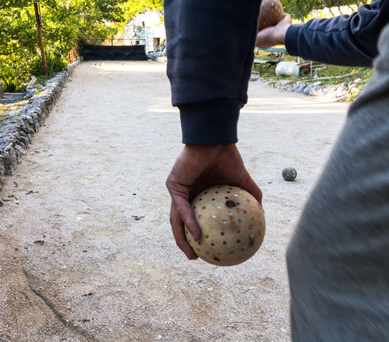 Man playing bocce game in Italy Balls Bocce Boccia Bowling Classic Close-up Court Day Game Italy Mediterranean  Men One Person Outdoor Outdoors People Real People Recreation  Sport Throw Tradition Traditional Wooden
