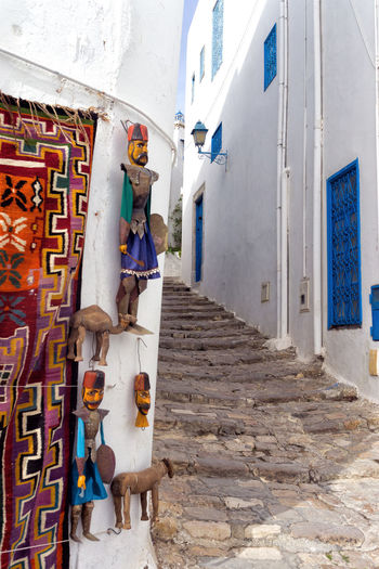Passage with arts and crafts in Sidi Bou Said, Tunisia. Architecture Building Building Exterior Outdoors Alley Holding Tunisia Sidi Bou Said Africa Tunis Mediterranean  House Market Urban Door Exterior Souvenir City Landmark Craft Crafts People Wall Built Structure