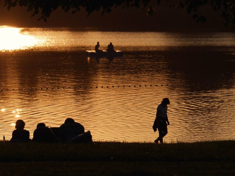 Abends am S E E Sunset Silhouette Water Reflection Scenics Real People Leisure Activity Outdoors Tranquility Mondsee