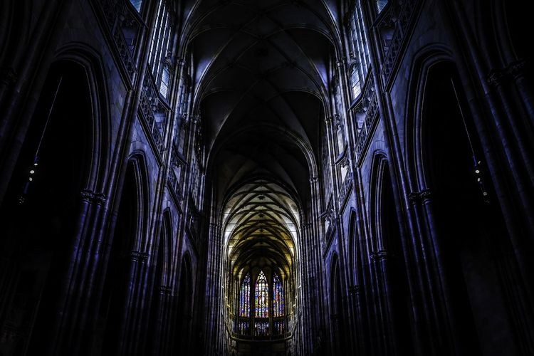 Dark Cathedral Architecture Cathedral Darkness Prague Stained Glass Travel Arch Architectural Column Architecture Architecture And Art Building Built Structure Dark darkness and light Gothic Style History Indoors  Low Angle View No People Place Of Worship Religion Spirituality Symmetry Travel Destinations Window EyeEmNewHere