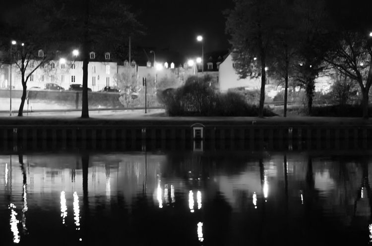 The Saar at night Architecture Black And White Built Structure Canal City City Life Dark Illuminated Nature Night No People Outdoors Reflection Reflections Reflections In The Water River Sky Street Light Tree Water