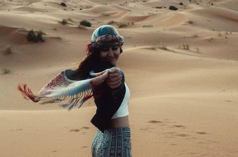 Woman wearing turban at beach