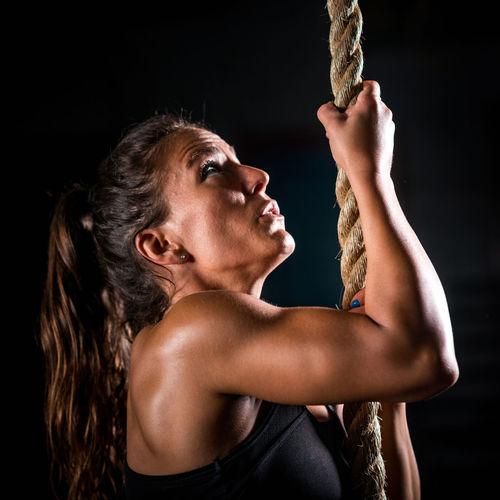 Athlete Climbing On Rope