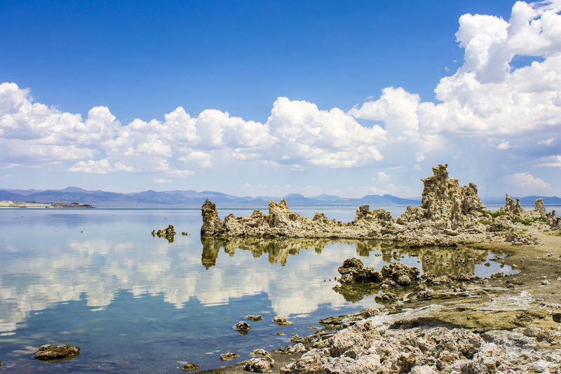 Mono Lake, a large, shallow saline soda lake in Mono County, California, with tufa rock formations Beauty In Nature Cloud - Sky Day Lake Landscape Mono Lake Mono Lake California Nature No People Outdoors Rock - Object Scenics Sky Tranquil Scene Tranquility Tree Tufa Water