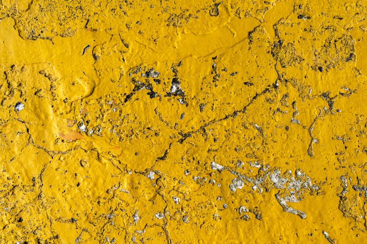 grungy aged yellow cement wall texture use as summer vacation background Vintage Yellow Cracked Wall Cracked Ground Cracked Cement Yellow Floor Painted Image Rough Wall - Building Feature Surface Texture