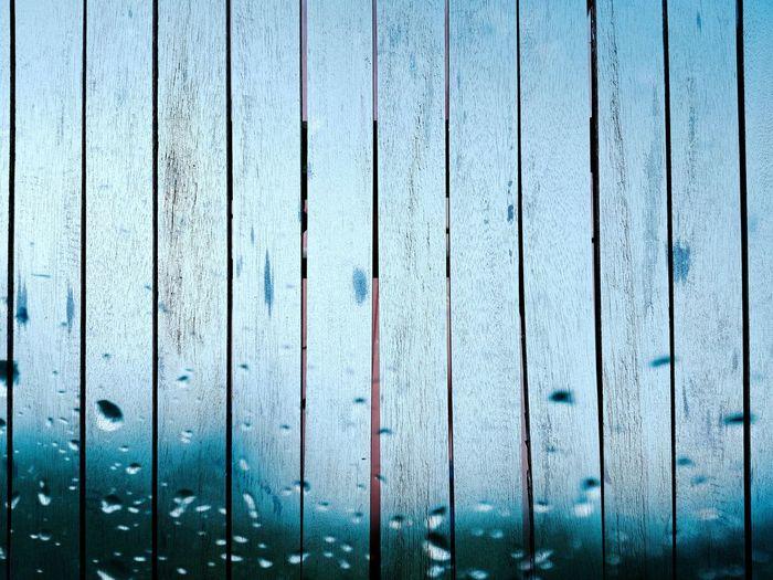 Full frame shot of wet wooden wall