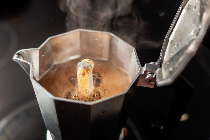Close-up of coffee in espresso maker at table