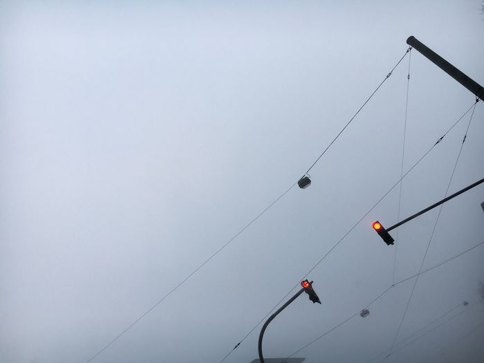 Adventure Low Angle View Transportation Outdoors Day Nature Sky Overhead Cable Car No People Traffic Traffic Lights Red Lights Transportation Automobile Drive City Bad Weather Dark Rain Grey Grey Day