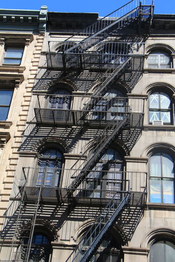 Manhattan buildings and park Arch Architecture Balcony Blue Building Building Exterior Built Structure City Day House Ladder Low Angle View Manhattan Manhattan Skyline No People Outdoors Railing Residential Building Residential Structure Sky Staircase Stairs Sunlight Window