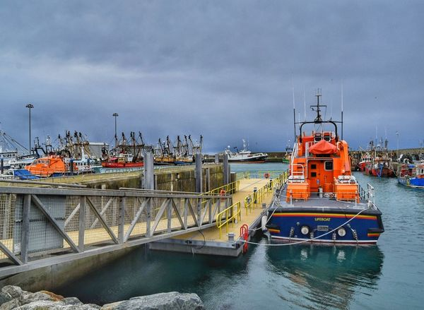 Nautical Vessel Mode Of Transport Transportation Moored Sky Water City Commercial Dock Business Finance And Industry Industry No People Passenger Craft Outdoors Harbor Ferry Day Ireland Orange Sea Wexford Kilmorequay Kilmore Quay Lifeboat Lifeboat RNLI