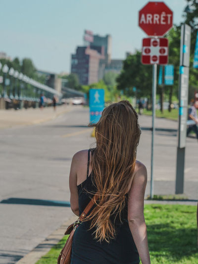 Casual Clothing City City City Life City Life Close-up Day Focus On Foreground Leisure Activity Life Lifestyles Long Hair Montréal Outdoors People Pole Selective Focus Street Streetphotography Style Walking Around Woman Woman Portrait