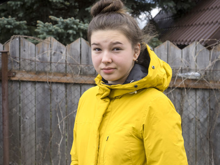 Yellow Portrait Looking At Camera One Person Clothing Front View Standing Waist Up Lifestyles Smiling Hair Young Adult Leisure Activity Day Real People Beauty Hairstyle Focus On Foreground Beautiful Woman Teenager Warm Clothing Hood - Clothing