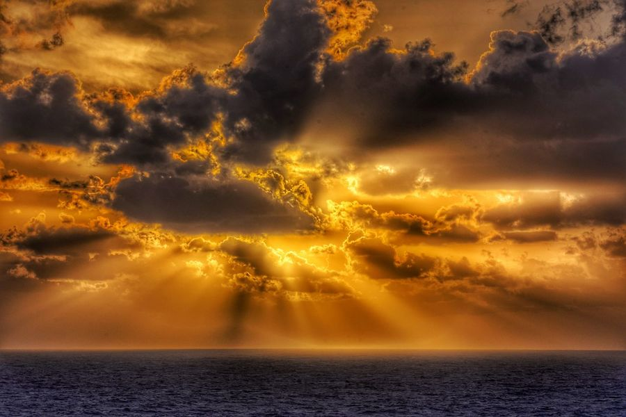 Sunset Sea Nature Beauty In Nature Dramatic Sky Scenics No People Outdoors Gold Colored Water Wave Sky Day Beach Cloud - Sky Dramatic Sky Horizon Over Water Natural Phenomenon Full Frame Sunbeam Tranquility Travel Destinations