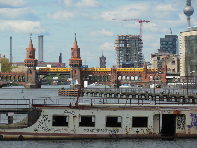 The river Spree was once part of the division of the city. It was for a number of years, after the fall of the Wall, the place for new music-clubs to establish. Names to mention are BAR25, Maria am Ostbahnhof, Yaam, Kater Holzig and currently the Holzmarkt. (2014) Berlin Oberbaumbrücke S-Bahn Berlin Spree Nautical Vessel Travel Destinations Water