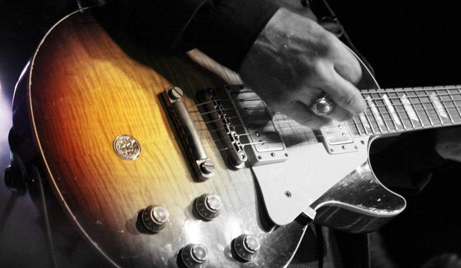 EyeEm Selects EyeEm Selects Vintagetrouble Music Musical Instrument Indoors  Guitar Arts Culture And Entertainment Electric Guitar Human Hand Real People Musical Instrument String One Person Skill  Occupation Playing Fretboard Close-up Musician Human Body Part Day People (null)Nalle Colt Vintage Trouble