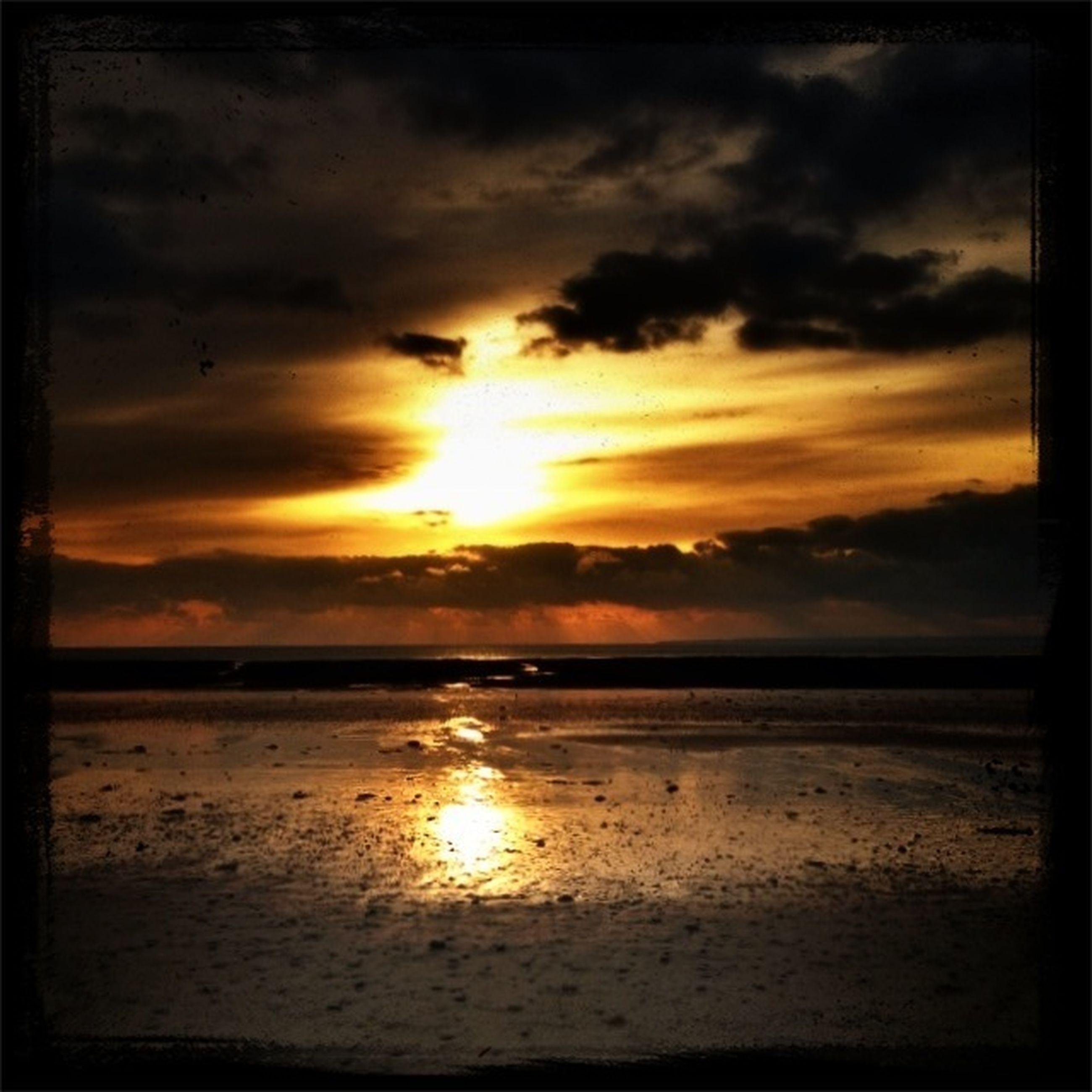 sunset, sun, water, scenics, sky, tranquil scene, sea, beauty in nature, tranquility, cloud - sky, reflection, beach, horizon over water, orange color, idyllic, nature, sunlight, sunbeam, shore, transfer print