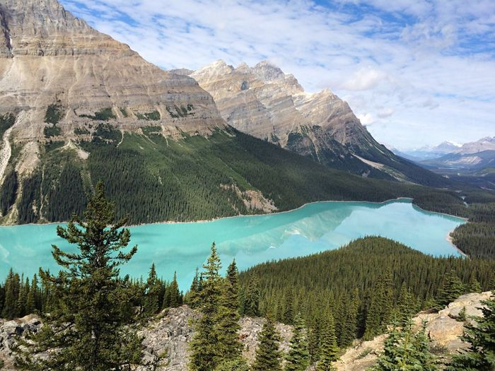Scenic view of peyto lake by canadian rockies mountains against sky