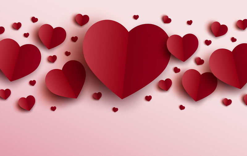 High angle view of heart shape against red background