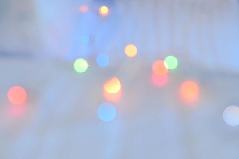 Defocused image of lights on street at night