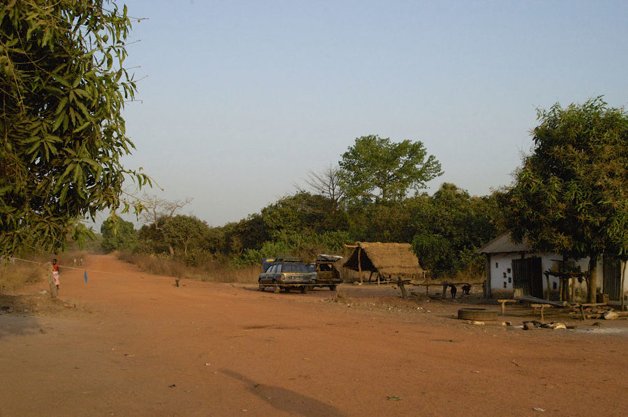 Border between Guinea-Bissau and Guinea Conacry at Burumtuma BorderTown Guinea Guinea-Bissau Republic Of Guinea-Bissau República Da Guiné-Bissau Road West Africa Africa African Border African Road Border Borderpost Car Day Dirt Road Nature Outdoors