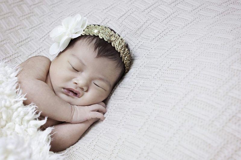 Close-up of cute sleeping newborn baby girl