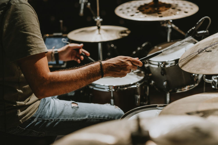 Man playing drums at music concert