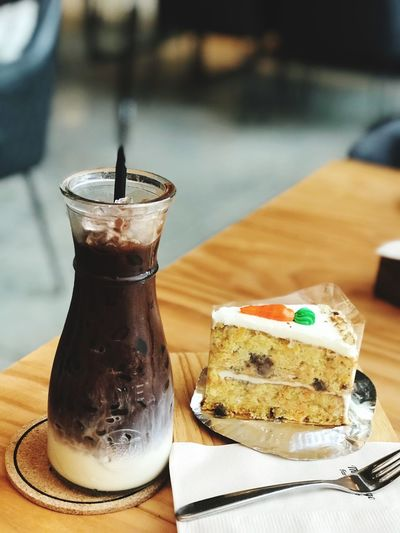 Close-up of cake and drink on restaurant table