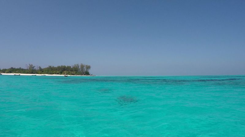 Turquoise Colored Sea Travel Destinations Vacations Zanzibar Tanzania Blue Tourism Beach Island Mnemba Island Bleu Plage Sable Mer île Bleu Sky Bleue