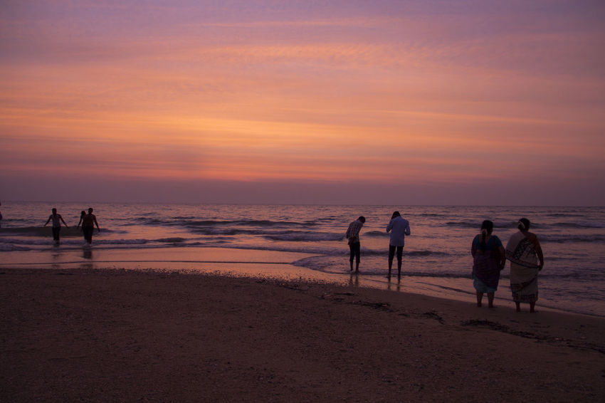 Feeling happy at dusk Adult Beach Beauty In Nature Canon 600D Dusk Colours EyeEm EyeEm Best Shots EyeEm Team Horizon Over Water Long Shot Love Is In The Air Nature New Perspective Outdoors People People Photography Sand Scenics Sea Seascape Seascape Photography Sky Sublime Landscapes Sunset Water