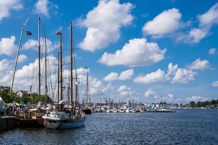 Sailing ships in Rostock, Germany. Architecture Building Exterior Built Structure City Cloud - Sky Day Harbor Mast Mode Of Transport Moored Nature Nautical Vessel Outdoors Port River Rostock Sailboat Sky Tall Ship Tourism Travel Destinations Warnow Water Waterfront Windjammer