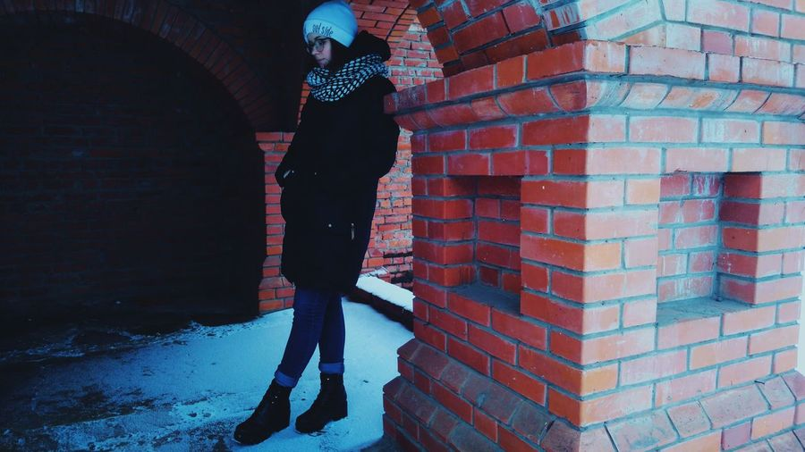 Woman Leaning On Column At Archway During Winter