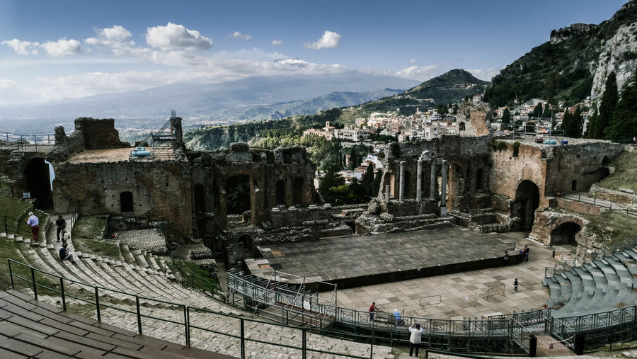 Ancient Theatre Of Taormina Against Sky In City