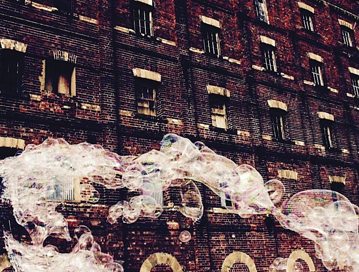Bubbles against an old brick factory Bubbles... Bubbles...Bubbles.... Bubbles In Front Of An Old Factory Brick Unused Factory Industrial