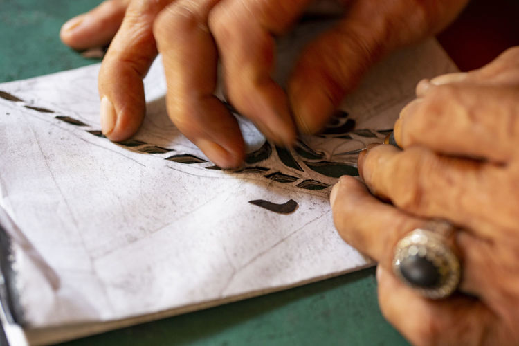 Cropped hand making paper decoration